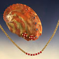 rubies & diamonds on abalone shell